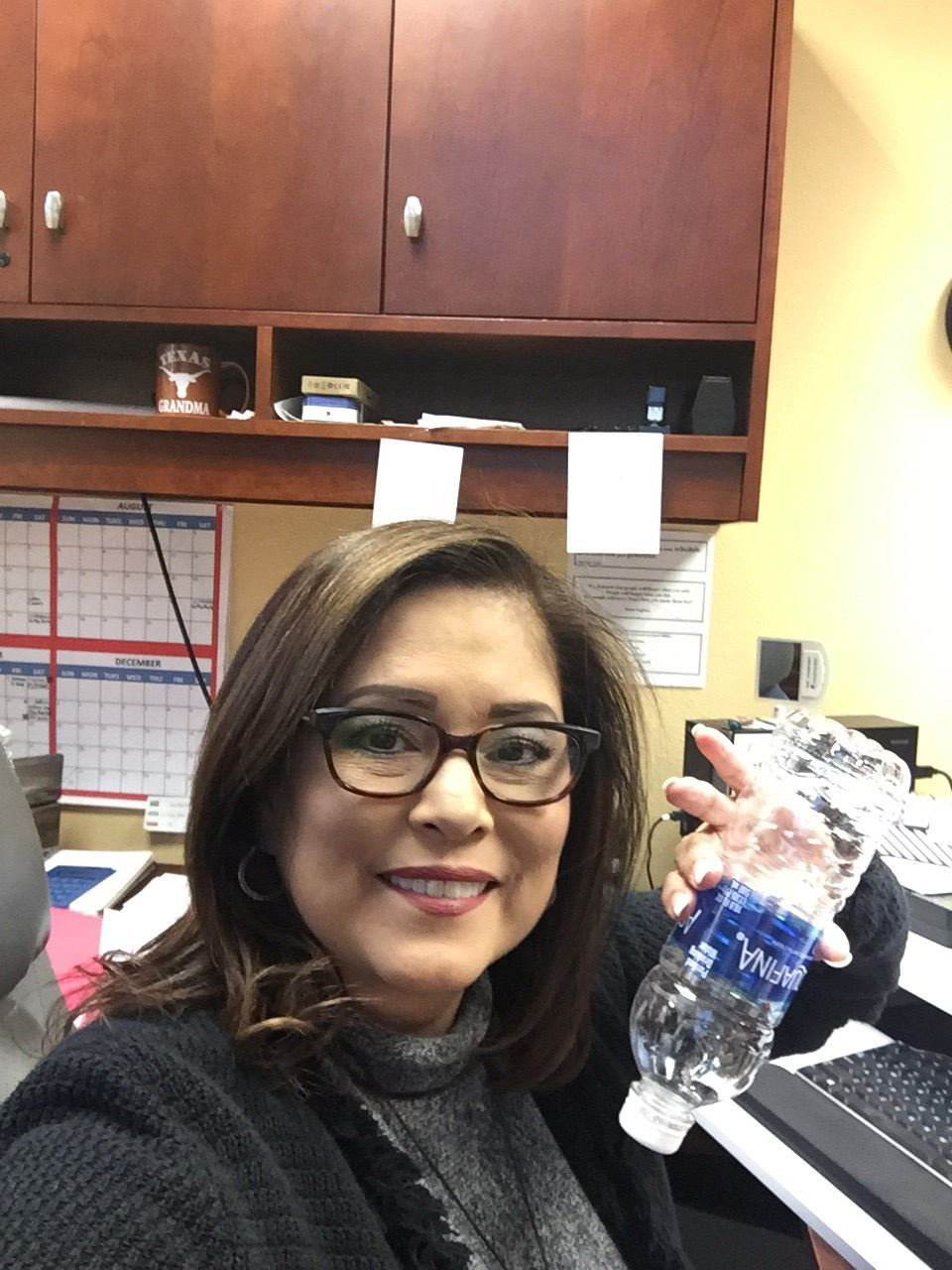 Jacque Vargas finishes another bottle of water